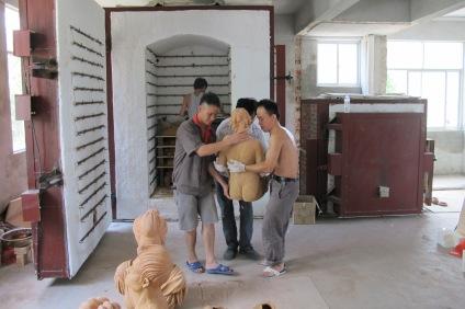 Loading the kiln with Studio Nong work at the PHuyai QunZhou NiXing Pottery Fasctory 2013